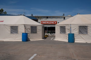 Intake tents set up for coronavirus disease (COVID-19) patients are seen outside of SSM Health St. Anthony Hospital in Shawnee, Oklahoma, U.S. March 26, 2020. REUTERS/Nick Oxford - RC21SF9PHFEU