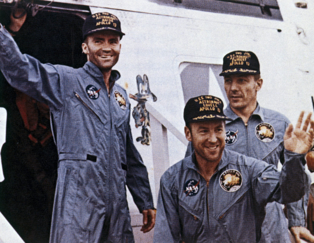Apollo 13 astronauts James Lovell, John Swigert and Fred Haise returned safely to Earth after a forced trans-lunar flight. The astronauts are shown soon after their rescue still unshaven and wearing space overalls. Photo by SSPL/Getty Images