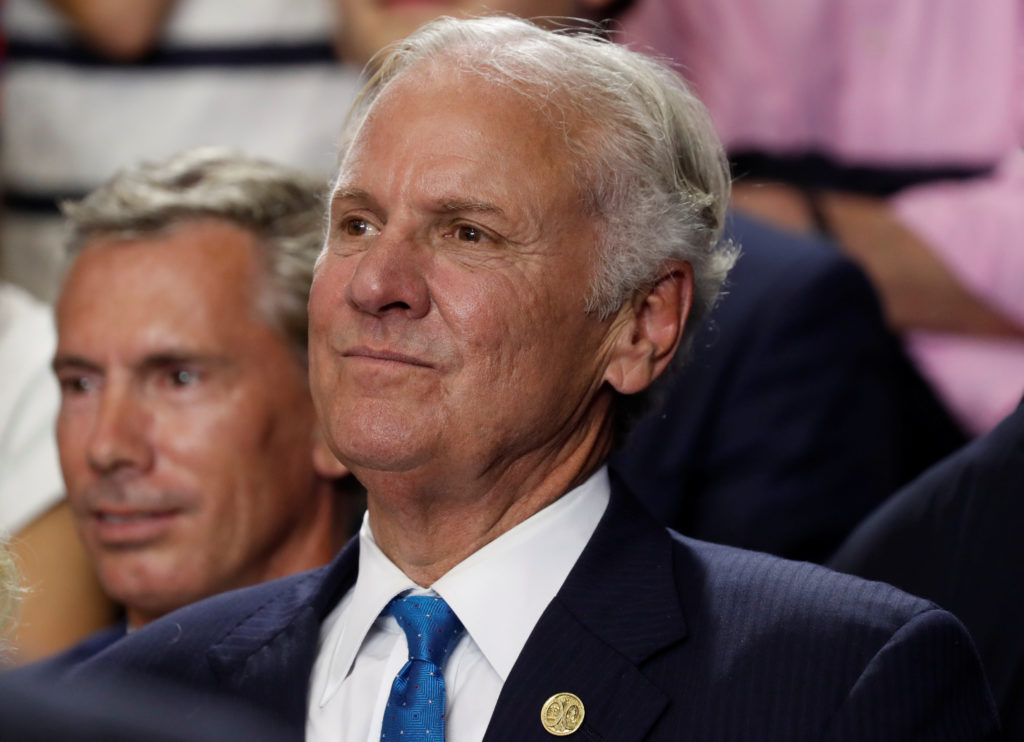 South Carolina Governor Henry McMaster looks on at a rally in Colum…