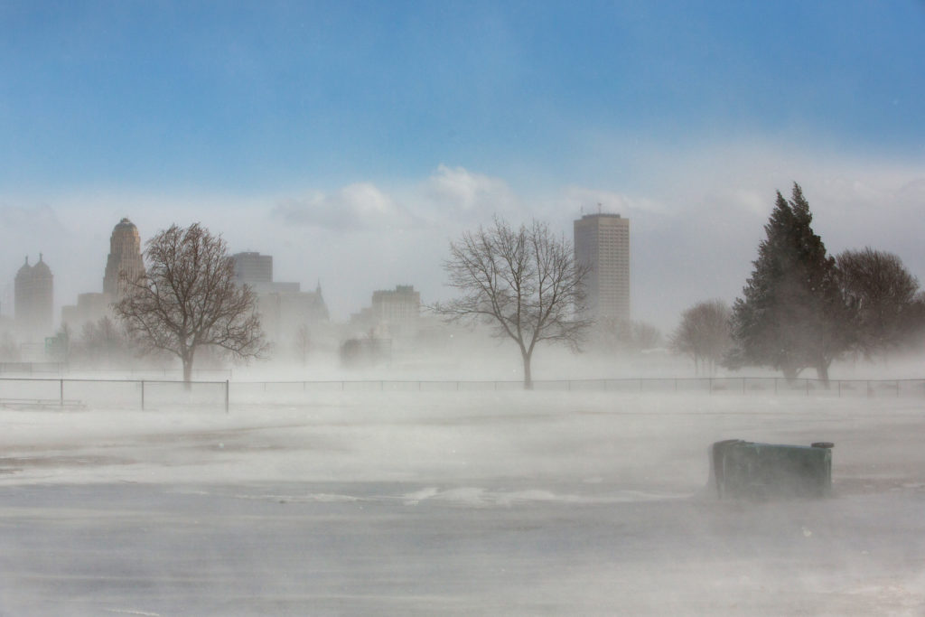 The city skyline is seen in drifting snow during the polar vortex in Buffalo, New York, U.S., January 31, 2019. Photo by REUTERS/Lindsay DeDario