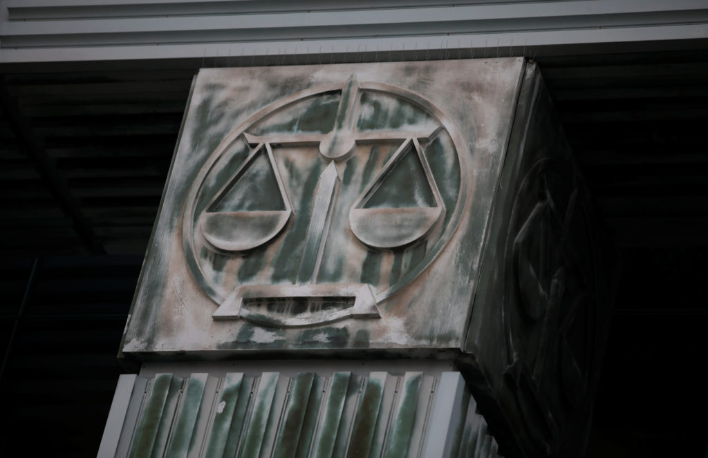 An image of scales is pictured on a pillar of the Supreme Court in Warsaw, Poland October 23, 2019. Photo by REUTERS/Kacpe...