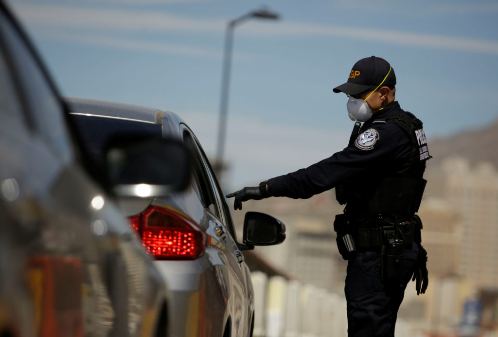 U.S. sues Texas to block state troopers from stopping migrants