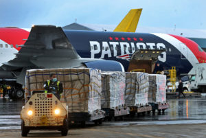 A New England Patriots Boeing 767-300 jet with a shipment of over one million N95 masks from China, which will be used in Boston and New York to help fight the spread of the coronavirus disease (COVID-19), arrives at Logan Airport, Boston, Massachusetts, U.S., April 2, 2020. Photo by Jim Davis/Pool via REUTERS