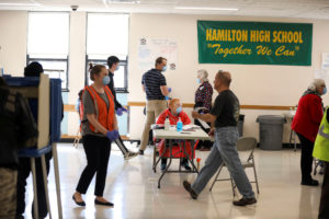 FILE PHOTO: Poll workers stand inside Hamilton High School during the presidential primary election, held amid the coronavirus disease (COVID-19) outbreak, in Milwaukee, Wisconsin, U.S., April 7, 2020. Photo by REUTERS/Daniel Acker/File Photo