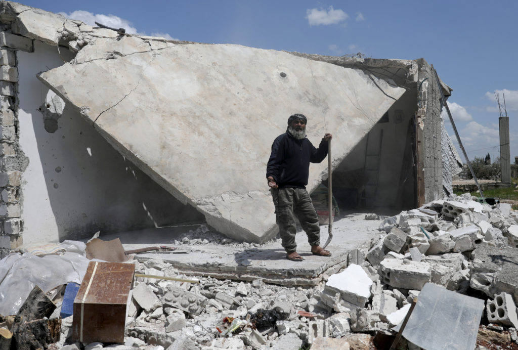 Taher al-Matar, 42, gestures as he stands near the rubble of his damaged house in the rebel-held town of Nairab, Idlib region, Syria April 17, 2020. Picture taken April 17, 2020. Photo by REUTERS/Khalil Ashawi