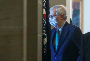 U.S. Senate Majority Leader Mitch McConnell (R-KY) wears a protective mask as he arrives at his office inside the U.S. Capitol after senators returned to Capitol Hill amid concerns that their legislative sessions could put lawmakers and staff at risk of contracting the coronavirus in Washington, U.S., May 4, 2020. Photo by REUTERS/Leah Millis