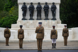 Senior officers and soldiers of the Household Division stand in front of Guards Memorial in St James's Park during a two minute silence to commemorate the 75th Anniversary of VE Day, London, Britain, May 8, 2020. Photo by REUTERS/Hannah