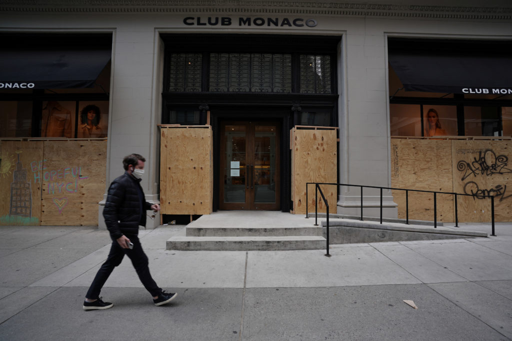 A closed Club Monaco store is covered in plywood, as retail sales suffer record drop during the outbreak of the coronavirus disease (COVID-19) in New York City, New York, U.S., April 15, 2020. REUTERS/Bryan R Smith - RC285G9L0TBR