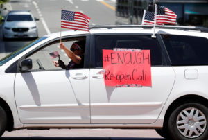 Demonstrators attend a vehicle caravan protest to call on state and local officials to re-open the economy, during the coronavirus disease (COVID-19) outbreak, near Los Angeles City Hall, Los Angeles, California, U.S., April 22, 2020. REUTERS/Mike Blake - RC2W9G91F1BW