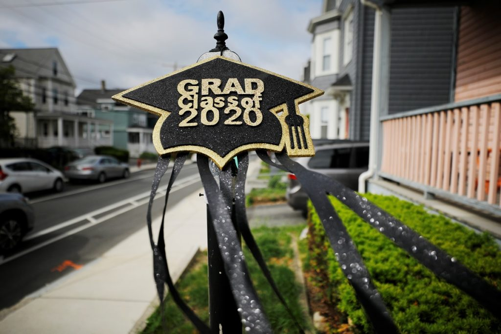 "A graduation sign outside a home reads ""Grad Class of 2020"" as in-person high school and college graduations and commencements have been cancelled or postponed because of the coronavirus disease (COVID-19) outbreak in Somerville, Massachusetts, U.S., May 28, 2020. Photo by REUTERS/Brian Snyder"
