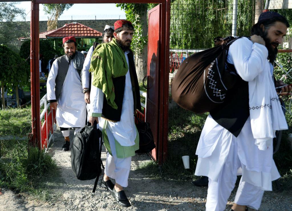 News Wrap: Afghan government begins releasing Taliban prisoners