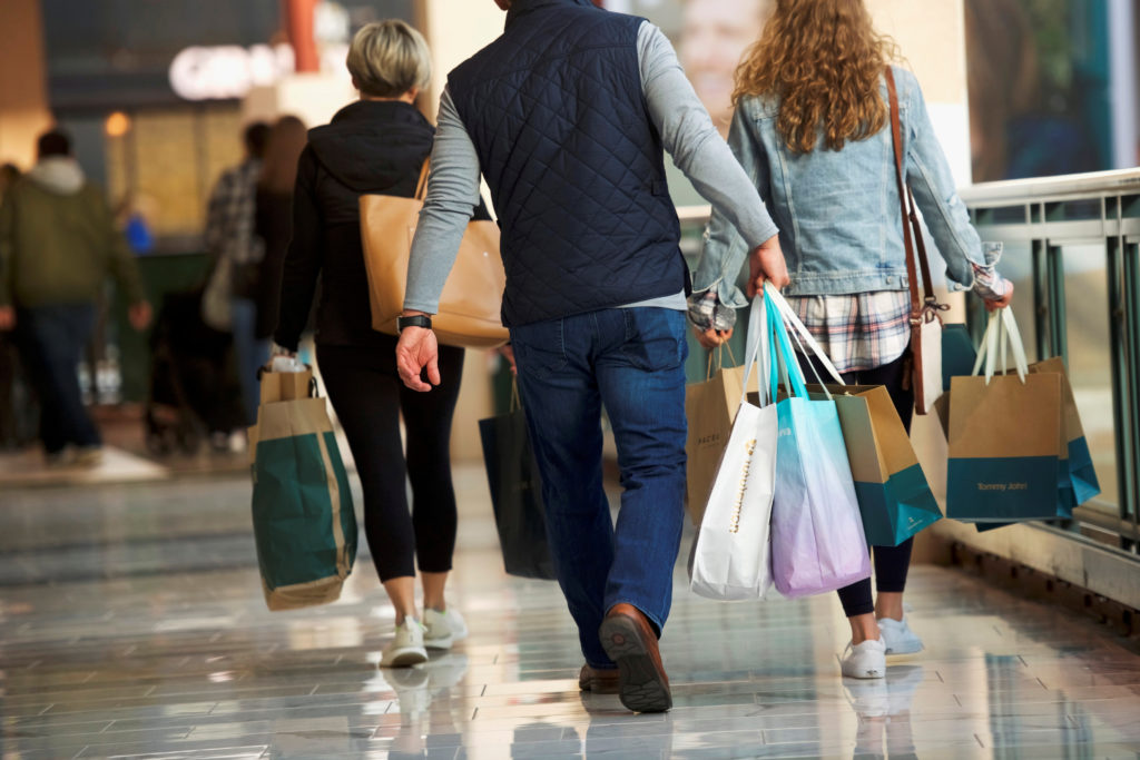 FILE PHOTO: Shoppers carry bags of purchased merchandise at the King of Prussia Mall, United States' largest retail shopping space, in King of Prussia, Pennsylvania, U.S., December 8, 2018. Photo by REUTERS/Mark Makela/File Photo