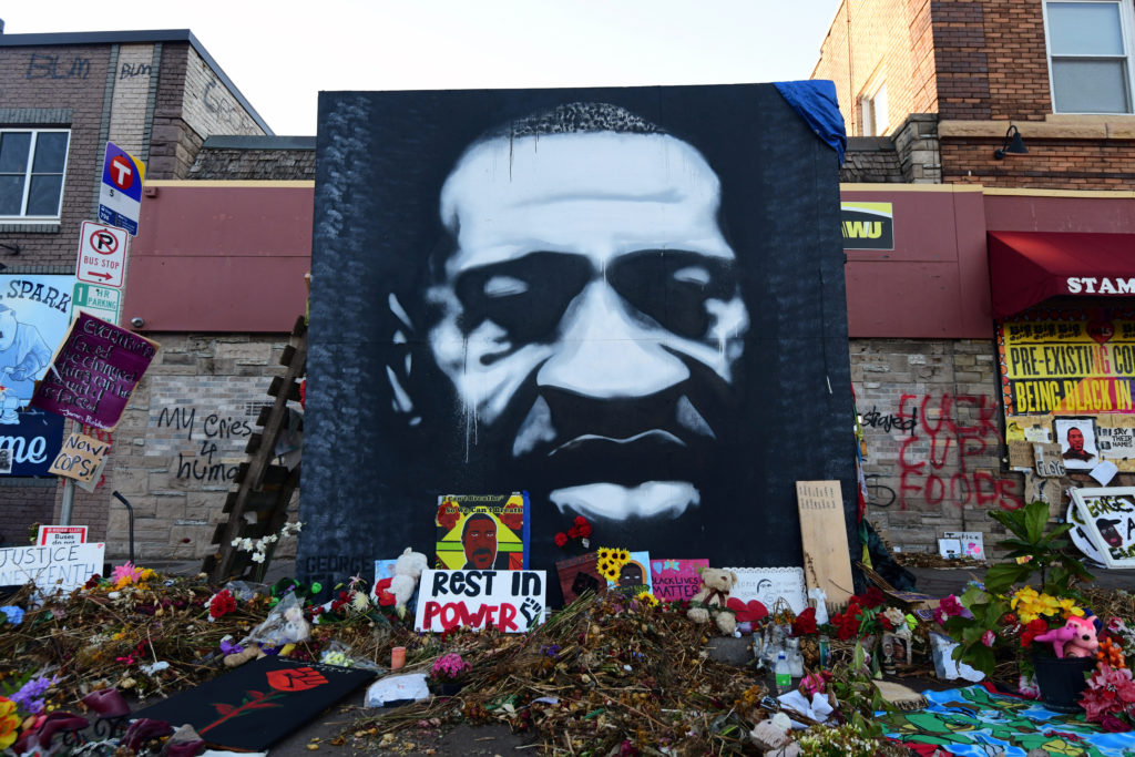 A memorial to George Floyd, who died after a white Minneapolis police officer pressed his knee into his neck on May 25, is lit by morning light one month later in Minneapolis, Minnesota, U.S. June 25, 2020. Photo by REUTERS/Nicholas Pfosi