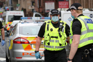 Police officers work at the scene of reported multiple stabbings at West George Street in Glasgow, Scotland, Britain June 26, 2020. Photo by REUTERS/Russell Cheyne