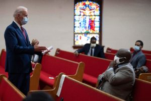 """Former vice president and Democratic presidential candidate Joe Biden(L) meets with clergy members and community activists during a visit to Bethel AME Church in Wilmington, Delaware on June 1, 2020. - Democratic presidential candidate Joe Biden visited the scene of an anti-racism protest in the state of Delaware on May 31, 2020, saying that the United States was """"in pain"""". """"We are a nation in pain right now, but we must not allow this pain to destroy us,"""" Biden wrote in Twitter, posting a picture of him speaking with a black family at the cordoned-off site where a protesters had gathered on Saturday night. (Photo by JIM WATSON / AFP) (Photo by JIM WATSON/AFP via Getty Images)"""