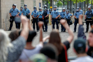 People gather at the Minneapolis Police Department's Third Precinct station to protest, after a white police officer was caught on a bystander's video pressing his knee into the neck of African-American man George Floyd, who later died at a hospital, in Minneapolis, Minnesota, U.S. May 27, 2020. REUTERS/Eric Miller - RC2FXG97YM9T