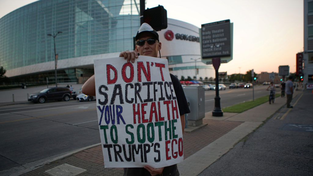 A non-supporter of U.S. President Donald Trump camps outside athe BOK Center, the venue for his upcoming rally, in Tulsa, Oklahoma, U.S. June 17, 2020. Photo taken June 17, 2020. REUTERS/Lawrence Bryant - RC2HBH9BEI3F