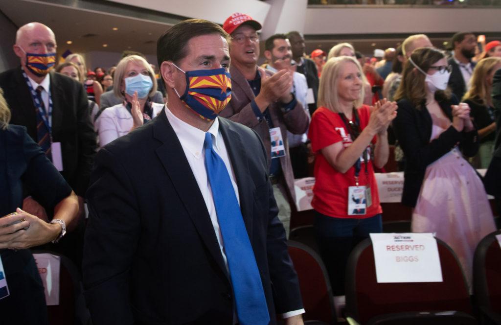 Arizona Governor Doug Ducey listens as US President Donald Trump sp…