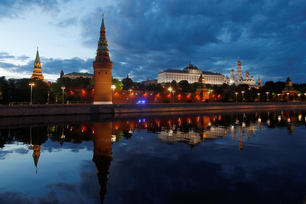 An ambulance moves past Kremlin as the spread of the coronavirus di…