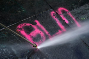 "A worker uses a pressure washer to remove a BLM graffiti after police dismantled the ""City Hall Autonomous Zone"" that was in support of the Black Lives Matter movement in the Manhattan borough of New York City, New York, U.S., July 22, 2020. Photo by REUTERS/Carlo Allegri"
