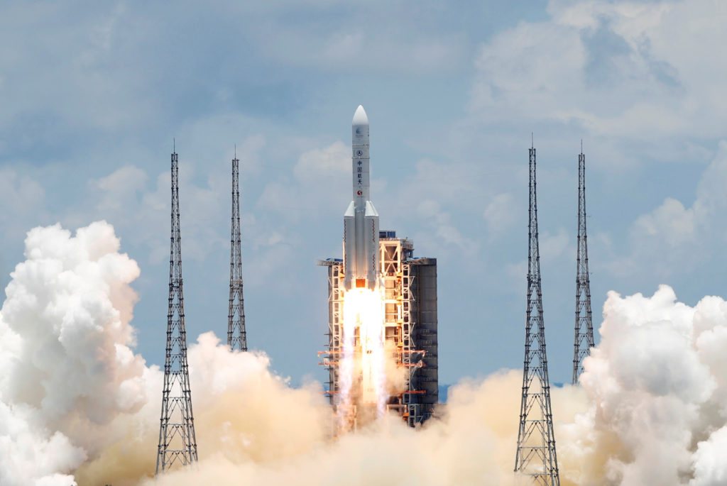 The Long March 5 Y-4 rocket, carrying an unmanned Mars probe of the Tianwen-1 mission, takes off from Wenchang Space Launc...