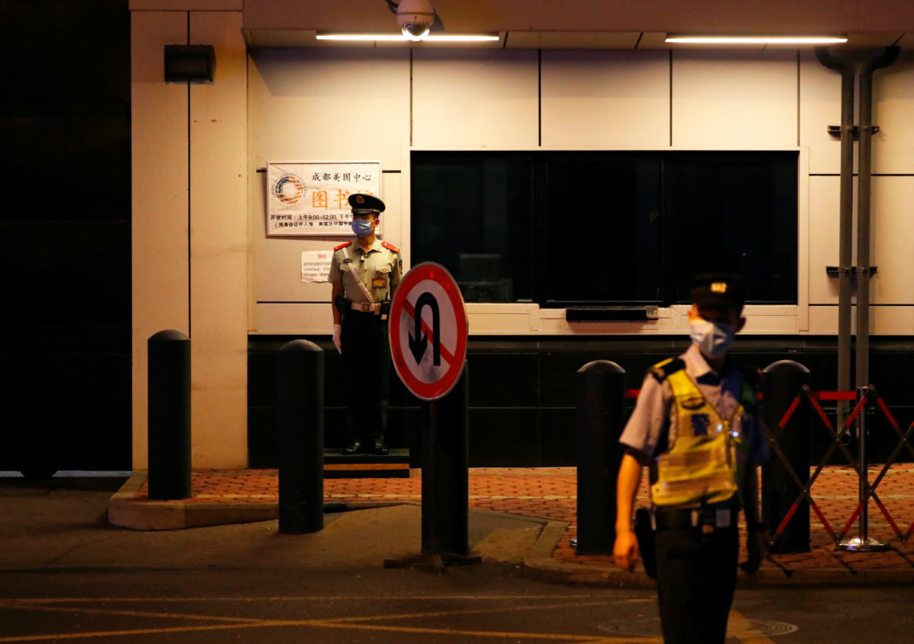 Police officers stand guard outside the U.S. Consulate General in Chengdu, Sichuan province, China July 24, 2020. Photo by...
