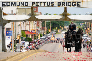The late U.S. Congressman John Lewis, a pioneer of the civil rights movement and long-time member of the U.S. House of Representatives who died July 17, is carried via horse-drawn carriage across the Edmund Pettus Bridge in Selma, Alabama, U.S. July 26, 2020. Photo by Reuters/Elijah Nouvelage