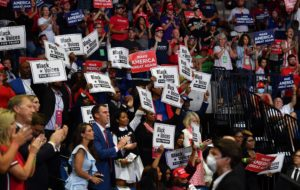 "Governor Kevin Stitt claps among ""Black Voices for Trump"" supporters as US President Donald Trump speaks during a campaign rally at the BOK Center on June 20, 2020 in Tulsa, Oklahoma. - Hundreds of supporters lined up early for Donald Trump's first political rally in months, saying the risk of contracting COVID-19 in a big, packed arena would not keep them from hearing the president's campaign message. (Photo by Nicholas Kamm / AFP) (Photo by NICHOLAS KAMM/AFP via Getty Images)"