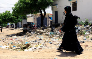 Jihan Ali Mohamud, 24, leaves her house as she goes to the national coronavirus disease call centre where they supervise calls to a free hotline number as a response to the spread of the coronavirus disease (COVID-19), in Mogadishu, Somalia, June 2, 2020. Picture taken June 2, 2020. Photo by REUTERS/Feisal Omar