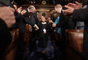 Supreme Court Justice Ruth Bader Ginsburg (L) is greeted as she arrives prior to U.S. President Barack Obama's address to a joint session of Congress in Washington, February 24, 2009. REUTERS/Pablo Martinez Monsivais/Pool (UNITED STATES)