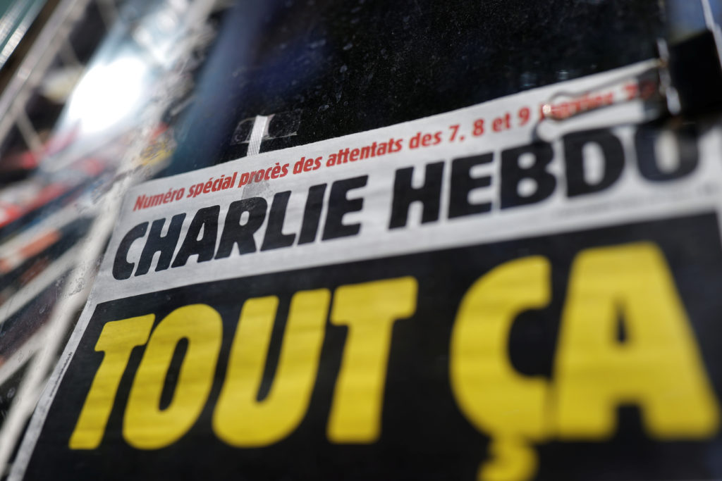 The front page of French satirical magazine Charlie Hebdo is seen at a newspapers kiosk in Paris on the opening day of the trial of the January 2015 Paris attacks against Charlie Hebdo satirical weekly, a policewoman in Montrouge and the Hyper Cacher kosher supermarket, at Paris courthouse, France, Steptember 2, 2020. The trial will take place from September 2 to November 10. Photo by Christian Hartmann/Reuters