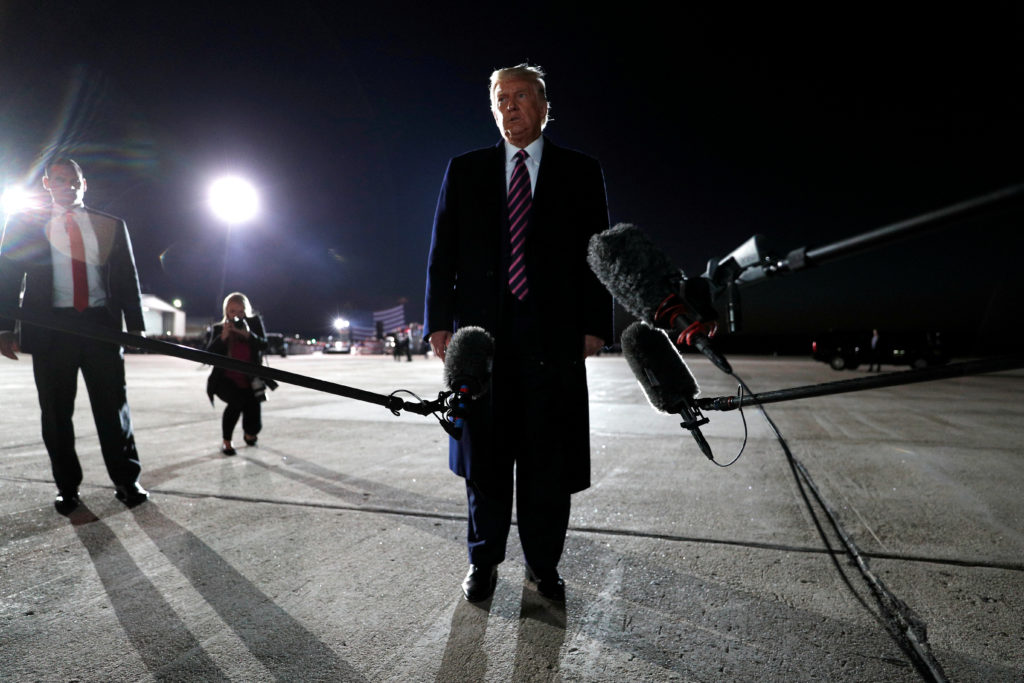 U.S. President Donald Trump speaks to the media about the death of U.S. Supreme Court Justice Ruth Bader Ginsburg as he stands on the airport tarmac at Bemidji Regional Airport after his campaign rally in Bemidji, Minnesota, U.S., September 18, 2020. REUTERS/Tom Brenner