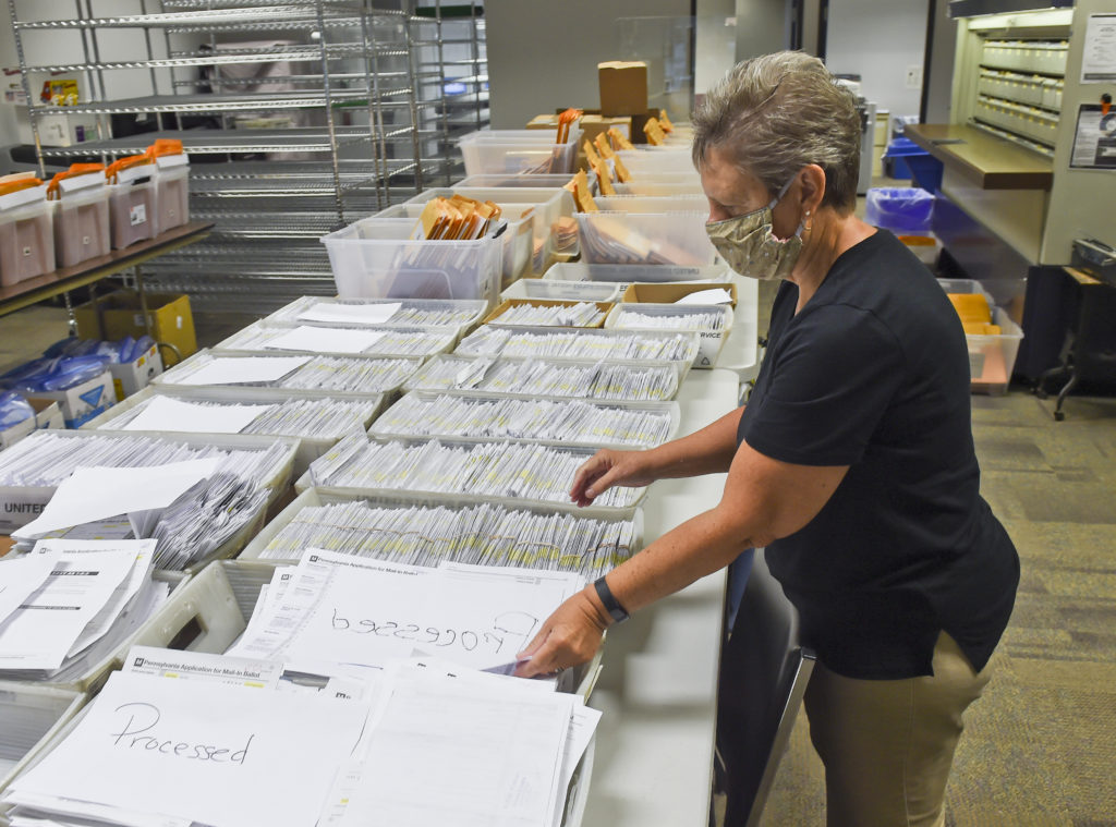 Donna Blatt, the chief registrar with the applications for mail-in ballots they have received. At the Berks County Office of Election Services  in the Berks County Services Building in Reading, PA Thursday morning September 3, 2020 where they are processing applications for mail-in ballots. (Photo by Ben Hasty/MediaNews Group/Reading Eagle via Getty Images)