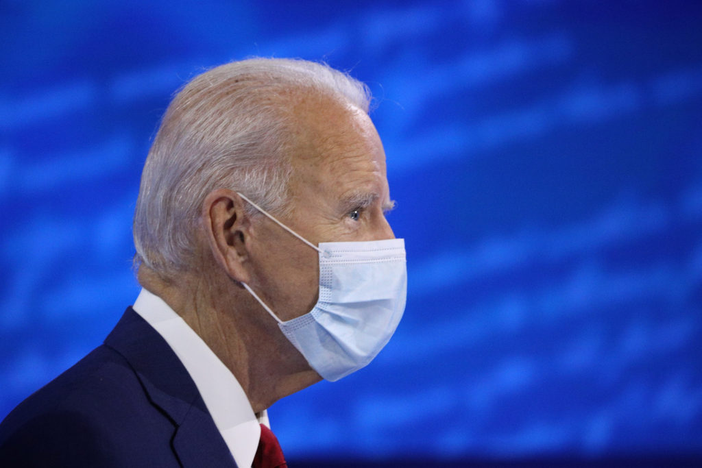 U.S. Democratic presidential candidate Joe Biden approaches his seat, ahead of an ABC Town Hall event at the National Cons...