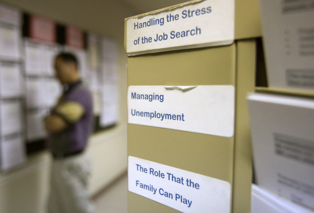 U.S. jobless claims remain high at 712,000 as virus escalates