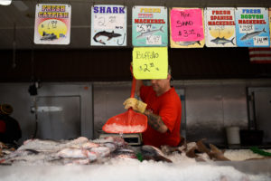 A worker puts ice on a selection of seafood for sale at Maine Avenue Fish Market which is the United States oldest fish market in continual operation since 1805, in Washington, U.S., May 6, 2019. Photo by REUTERS/Clodagh Kilcoyne