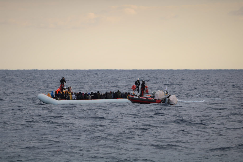 FILE PHOTO: Migrants wearing lifejackets on a rubber dinghy are pictured during a rescue operation by the MSF-SOS Mediterranee run Ocean Viking rescue ship, off the coast of Libya in the Mediterranean Sea, February 18, 2020. Picture taken February 18, 2020. Photo by Hannah Wallace Bowman/MSF/Handout via REUTERS