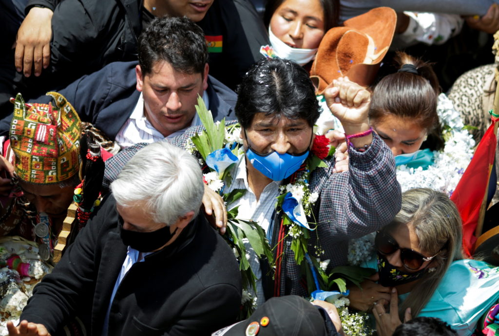 Former Bolivian President Evo Morales raises a fist as he returns to his home country from exile in Argentina, at the border town of Villazon, Bolivia, November 9, 2020. Photo by REUTERS/Ueslei Marcelino