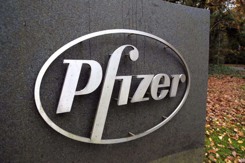 The Pfizer logo is seen at their UK commercial headquarters in Walton Oaks, Britain, November 11, 2020. Photo by Peter Czi...