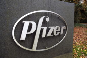 The Pfizer logo is seen at their UK commercial headquarters in Walton Oaks, Britain, November 11, 2020. Photo by Peter Cziborra/Reuters.