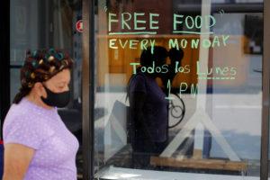 pedestrian walks near food pantry