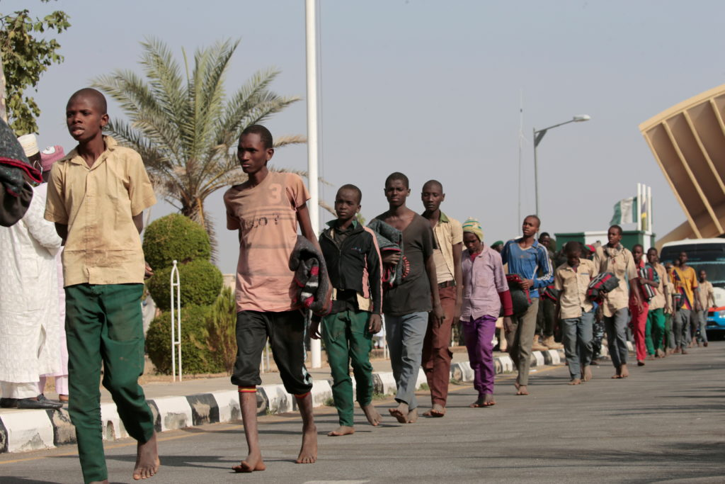 Freed Nigerian schoolboys walk after they were rescued by security forces in Katsina, Nigeria, December 18, 2020. Photo by Afolabi Sotunde/Reuters