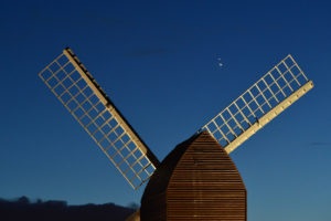Jupiter and Saturn are seen coming together in the night sky, over the sails of Brill windmill, for what is known as the Great Conjunction, on December 20, 2020 in Brill, England. The planetary conjunction is easily visible in the evening sky and will culminate on the night of December 21. This is the closest the planets have appeared for nearly 800 years. Photo by Jim Dyson/Getty Images