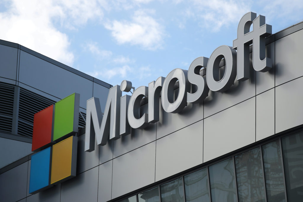 FILE PHOTO: A Microsoft logo is seen in Los Angeles, California U.S. November 7, 2017. Photo by Lucy Nicholson/File Photo/Reuters