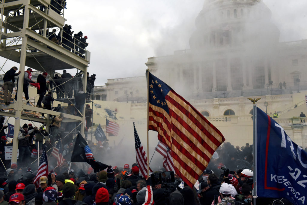 Supporters of President Donald Trump riot in front of the U.S. Capitol Building onJanuary 6, 2021.