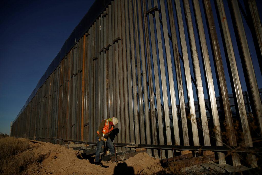 Biden halts border wall building after Trump's final surge | PBS NewsHour