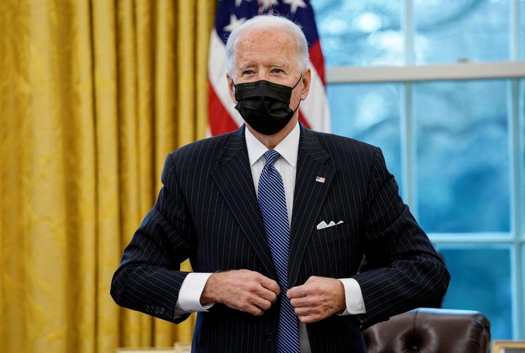 U.S. President Joe Biden prepares to meet with new U.S. Defense Secretary Lloyd Austin in the Oval Office at the White Hou...
