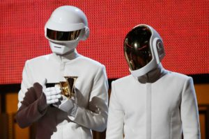 """Daft Punk accept the award for record of the year for """"Get Lucky"""" at the 56th annual Grammy Awards in Los Angeles, in January 2014."""