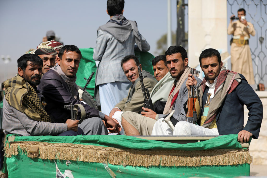 Armed Houthi followers ride on the back of a truck after participating in a funeral of Houthi fighters killed in recent fighting against government forces in Yemen's oil-rich province of Marib, in Sanaa, Yemen February 20, 2021. Photo by Reuters/Khaled Abdullah/File Photo