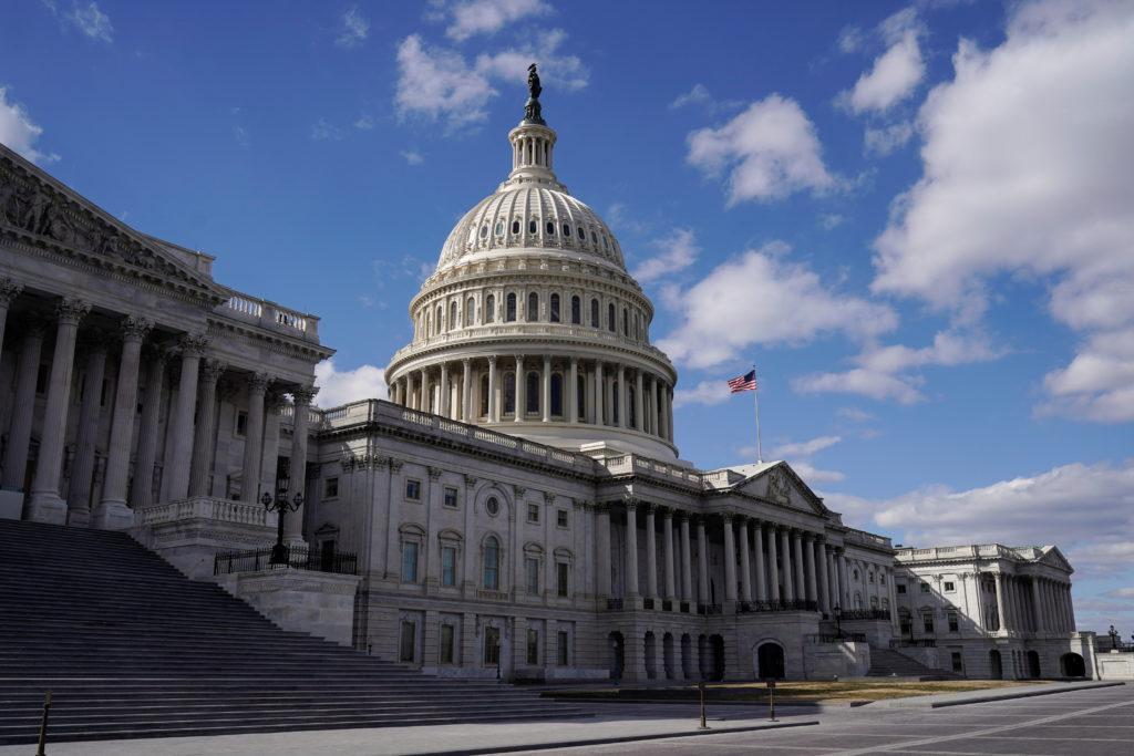 The sun shines on the U.S. Capitol after the Senate passed U.S. President Joe Biden's $1.9 trillion COVID-19 relief plan i...